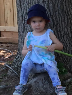 Granddaughter Abby sitting under a tree